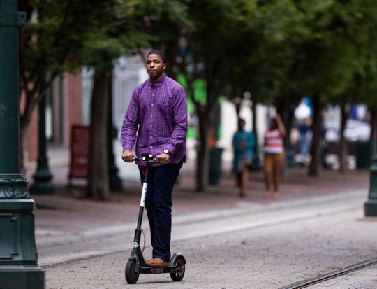 A rider makes his way down South Main Street on a Bird electric scooter in the Downtown Memphis, Tennessee  Wednesday October 10, 2018.