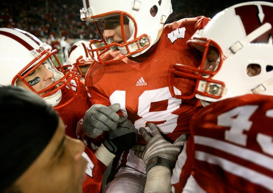 Wisconsin kicker Phillip Welch gets mobbed by teammates after making the game winning extra point in Wisconsin's 35-34 win over Cal Poly Saturday, November 22,2008, at Camp Randall Stadium.