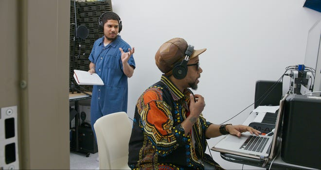 "Milwaukee native Todd ""Speech"" Thomas, from Grammy-winning hip-hop group Arrested Development, works with Anthony Johnston in a recording studio at the Richmond City Jail in a scene from the documentary ""16 Bars."""