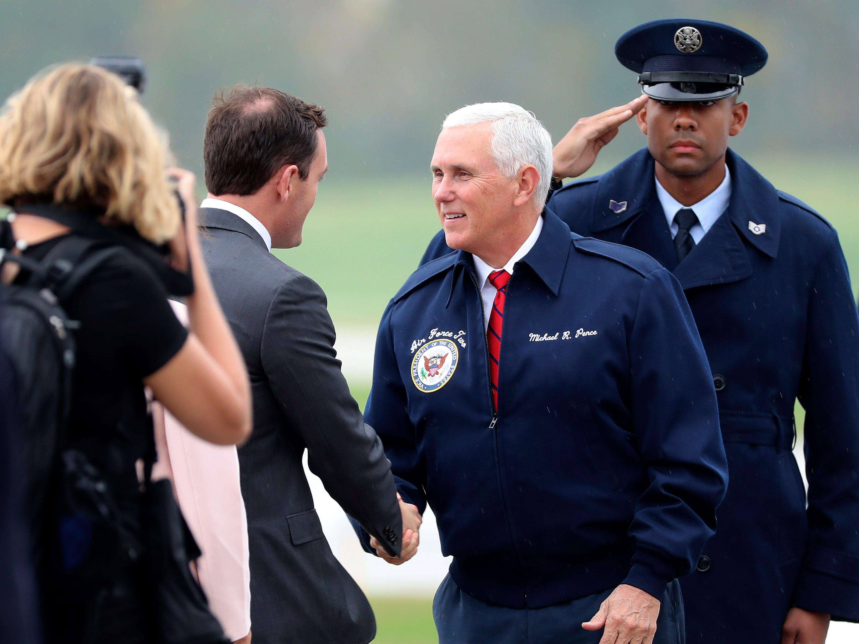 Vice President Mike Pence greets U.S. Rep. Mike Gallagher at Green Bay's Austin Straubel International Airport on Wednesday, Oct. 10, 2018.