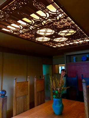 The dining room of the Frank Lloyd Wright home and studio in Oak Park, Illinois.