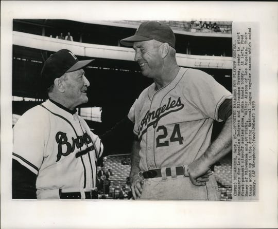 Managers for Los Angeles Dodgers (Walter Alston, right) and Milwaukee Braves (Fred Haney) ready to start first pennant playoff series game, shake hands in 1959 before a best-of-3 playoff battle.
