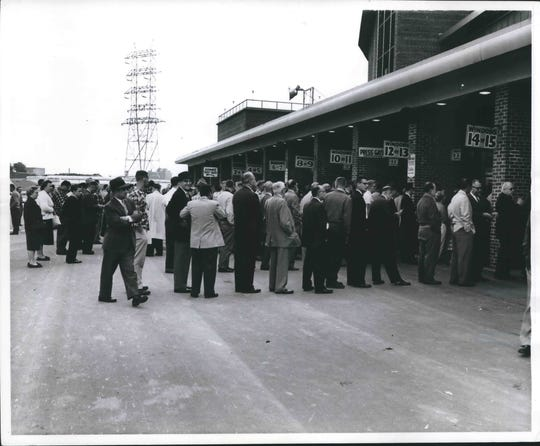 Against a leaden sky that threatened rain, baseball fans lined up Monday morning, September 28, 1959, at ticket windows at the County Stadium for seats for the opener of a playoff series between the Braves and the Los Angeles Dodgers.