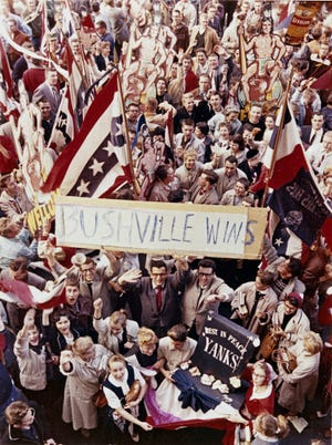 Fans pour onto Wisconsin Avenue to celebrate after the Milwaukee Braves defeat the New York Yankees in Game 7 of the 1957 World Series on Oct. 10, 1957. This photo was published in The Milwaukee Journal on Oct. 11, 1957.