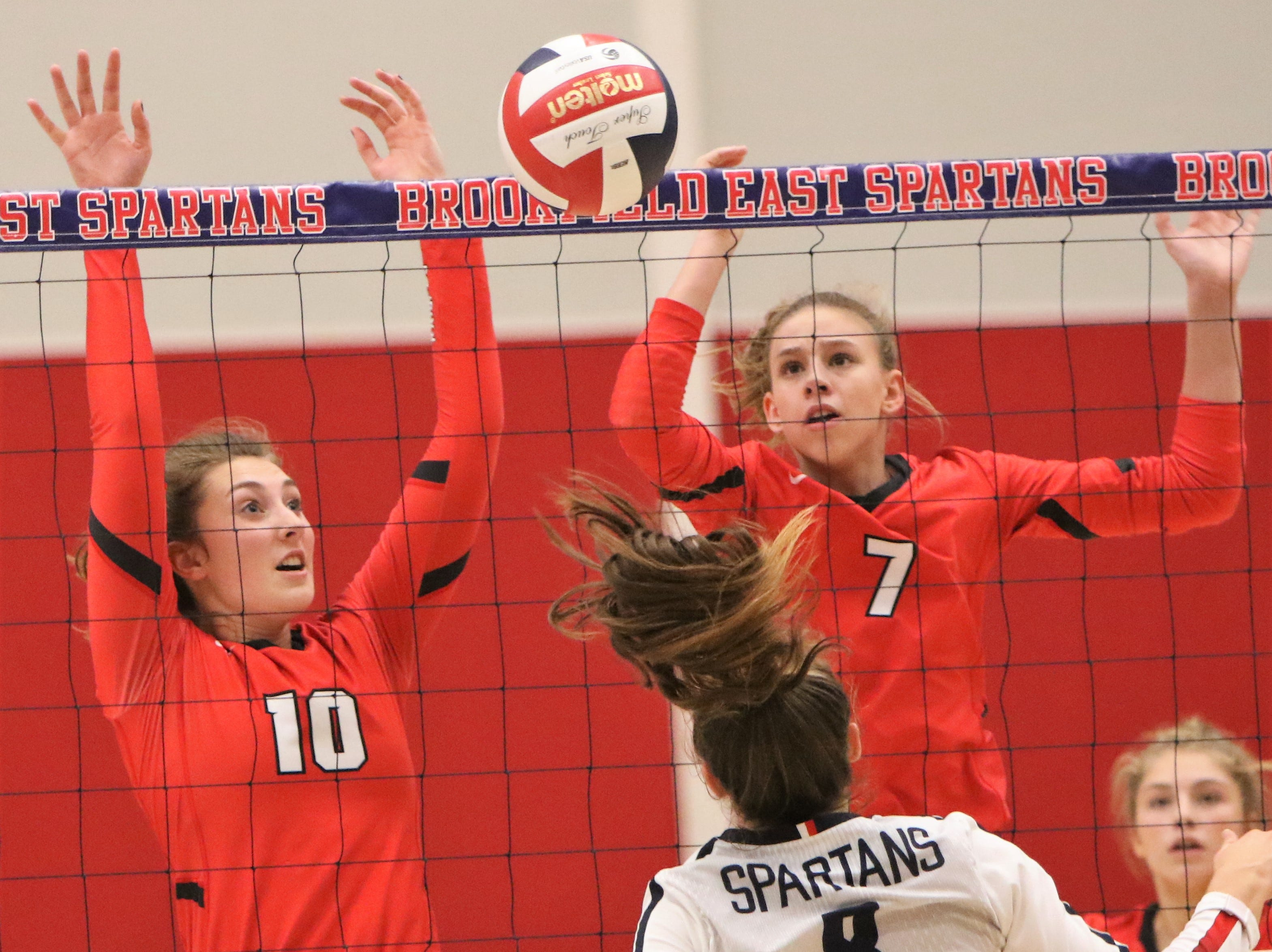 Wauwatosa East junior Sophia Wilhelm (right) watches her block go back over the net along with Anna Rossner during a match against Brookfield East on October 9.