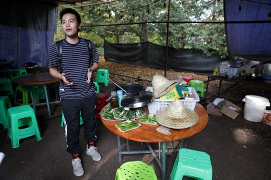 Craig Chen, on-site manager of Chinese artists and artisans at China Lights lantern festival, talks about food and appliances inside a cook tent at Boerner Botanical Gardens where the workers eat each meal of the day.