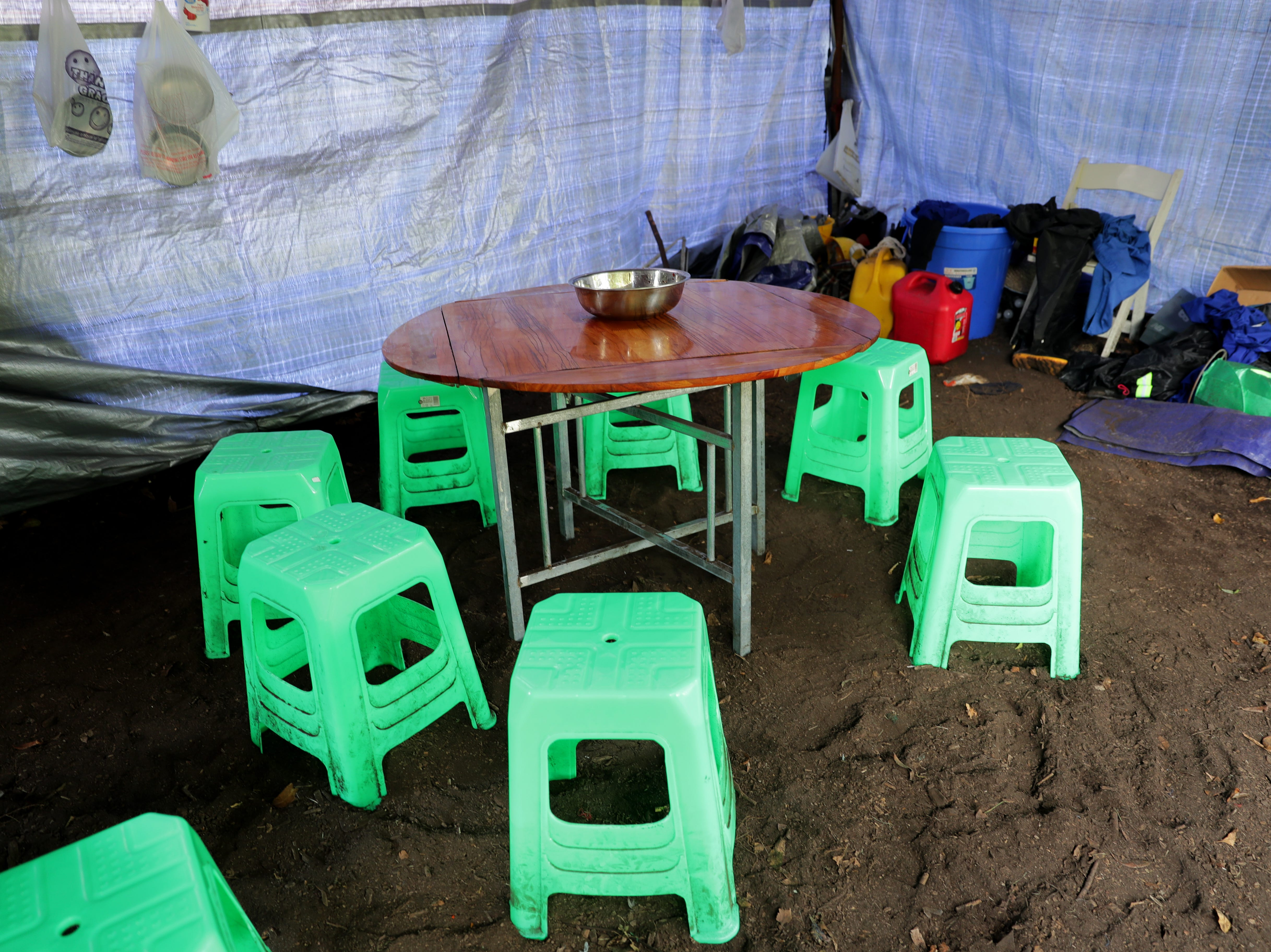 A table and chairs are set up in the Chinese workers' cook tent on the grounds near the exhibit.