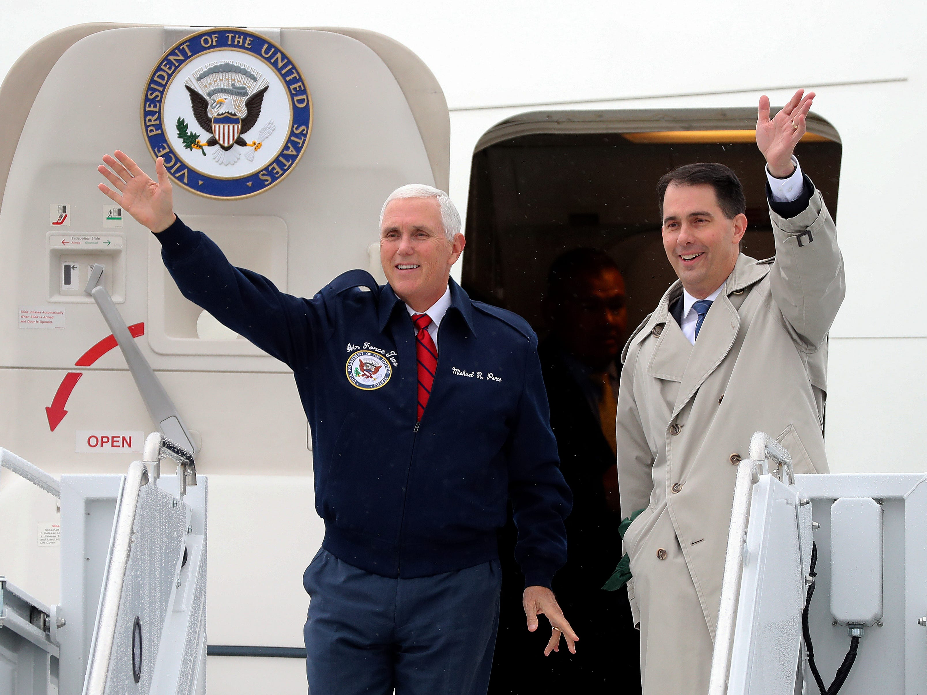Vice President Mike Pence (left) arrives at Green Bay's Austin Straubel International Airport with Gov. Scott Walker on Wednesday, Oct. 10, 2018.