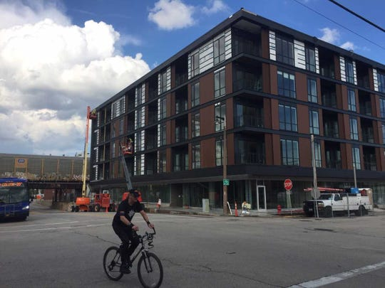 South Second Street in Walker's Point added dedicated bike lanes, part of the Complete Streets approach, which helps encourage commercial development, including The Quin apartments.