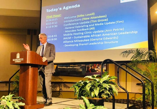 Marquette University President Mike Lovell leads a monthly brainstorming meeting Wednesday, where members strategize on ways to tackle the city's epidemic of trauma.