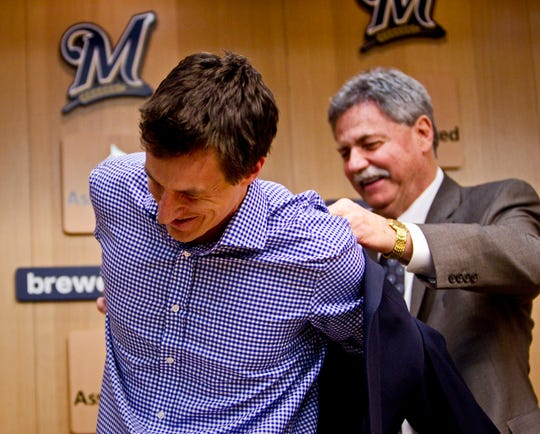 After his playing days ended following the 2011 season, Craig Counsell was helped into the Brewers' front office – and into a blazer instead of a uniform – by then-GM Doug Melvin.