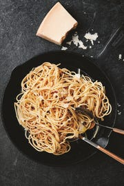 Supper can be as simple as spaghetti flavored with butter, garlic and Parmesan, ingredients most people have on hand.