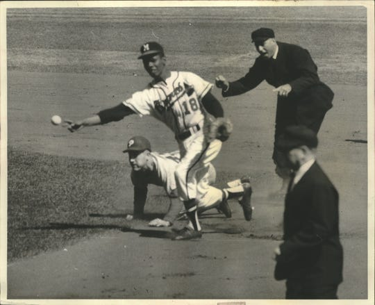 Braves second baseman Felix Mantilla (18) relays the ball to first after tagging out George Anderson of the Phillies in 1959.