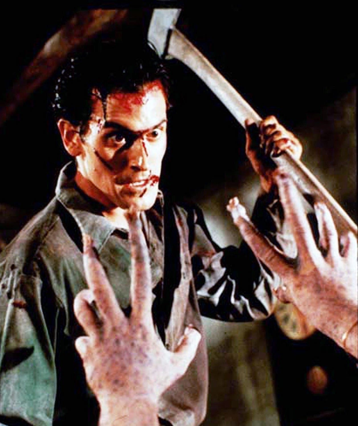 "Bruce Campbell plays Ash in the 1987 Sam Raimi horror film ""Evil Dead 2."""