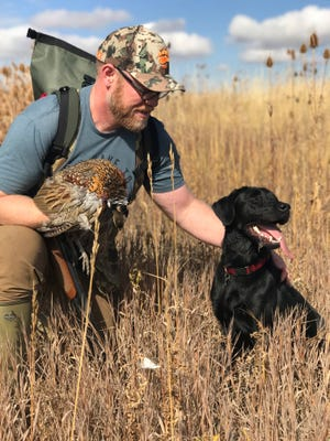 Land Tawney, CEO of Backcountry Hunters & Anglers, poses with Tule, his 1 1/2-year-old Labrador retriever, during an October 2018 hunt on public land in Montana.