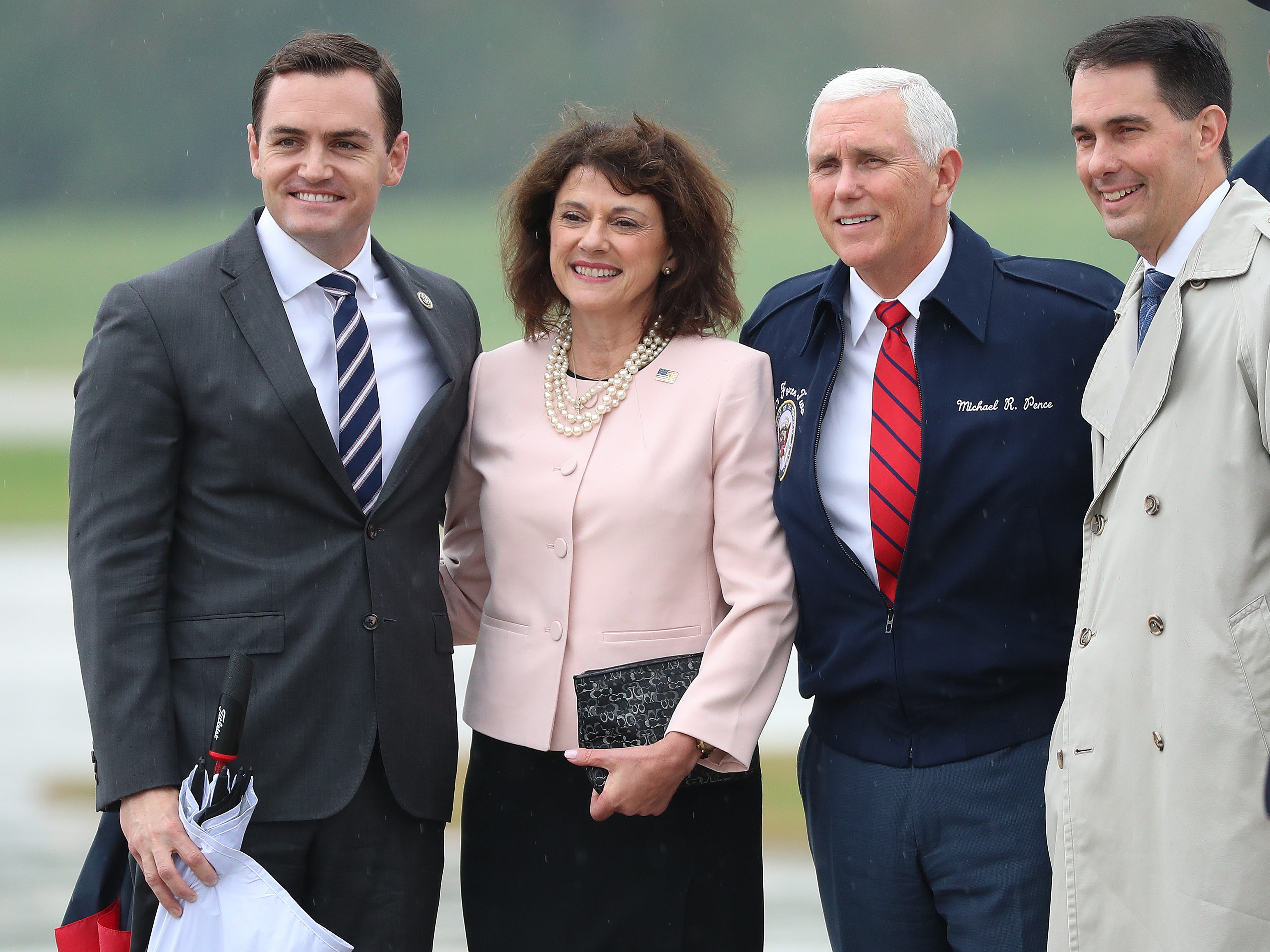 Vice President Mike Pence is flanked by  (from left) U.S. Rep. Mike Gallagher,  U.S. Senate candidate Leah Vukmir and Gov. Scott Walker on Wednesday, October 10, 2018,at Green Bay's Austin Straubel International Airport.