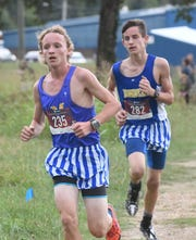 Mountain Home's Hendrix Hughes (left) and Ky Bickford lead the pack during the Bomber Invitational on Tuesday.