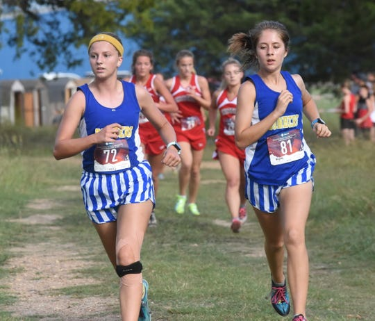 Mountain Home's Marcie Cudworth (left) and Rylee Patterson lead the pack early in the race during the Bomber Invitational on Tuesday.