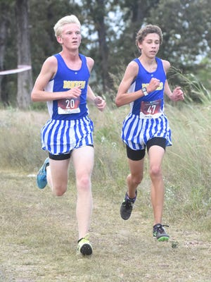 Mountain Home's Whit Lawrence (left) and Andrew Westphal race downhill during the Bomber Invitational on Tuesday.