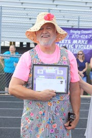 "Flippin Mayor Jerald Marberry won the award for Highest Heels at the sixth annual ""Walk a Mile in Her Shoes"" fundraiser for Serenity Inc."