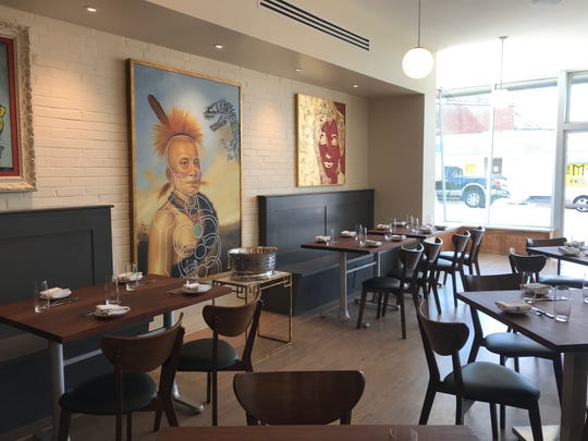 Cory Bahr has his personal art collection hanging on the walls of Parish Restaurant.