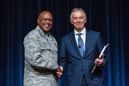 Lt. Gen. Anthony Cotton, Air University commander and president, presents a token of appreciation to former British Prime Minister Tony Blair for taking time to speak with the students of AU, Oct. 5, 2018, Maxwell Air Force Base, Ala. Blair received an illustrative history book about the Tuskegee Airmen, one of the major historical contributions made to aviation that took place here in Alabama.