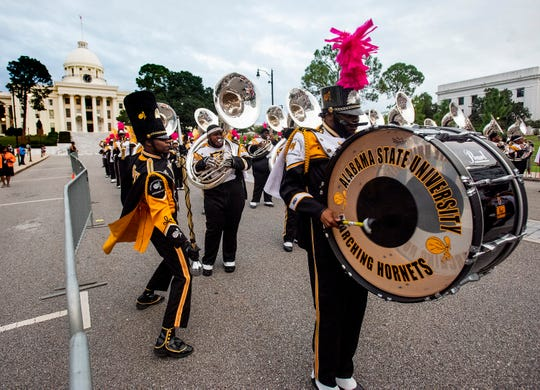 The Alabama State University Marching Hornets perform as NBC Nightly News anchor Lester Holt broadcasts live from Dexter Avenue in Montgomery, Ala., on Tuesday evening October 9, 2018.