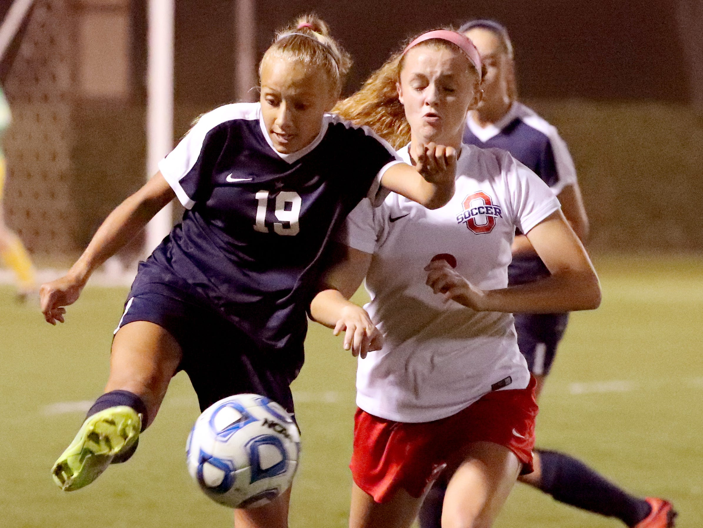 Siegel's Kyla Hawkins (19) moves the ball down the field as Oakland's Matty Snow (6) defends her in the semifinals of the 7-AAA Soccer Tournament, on Tuesday,  Oct. 09, 2018 at the Siegel Soccer Complex.