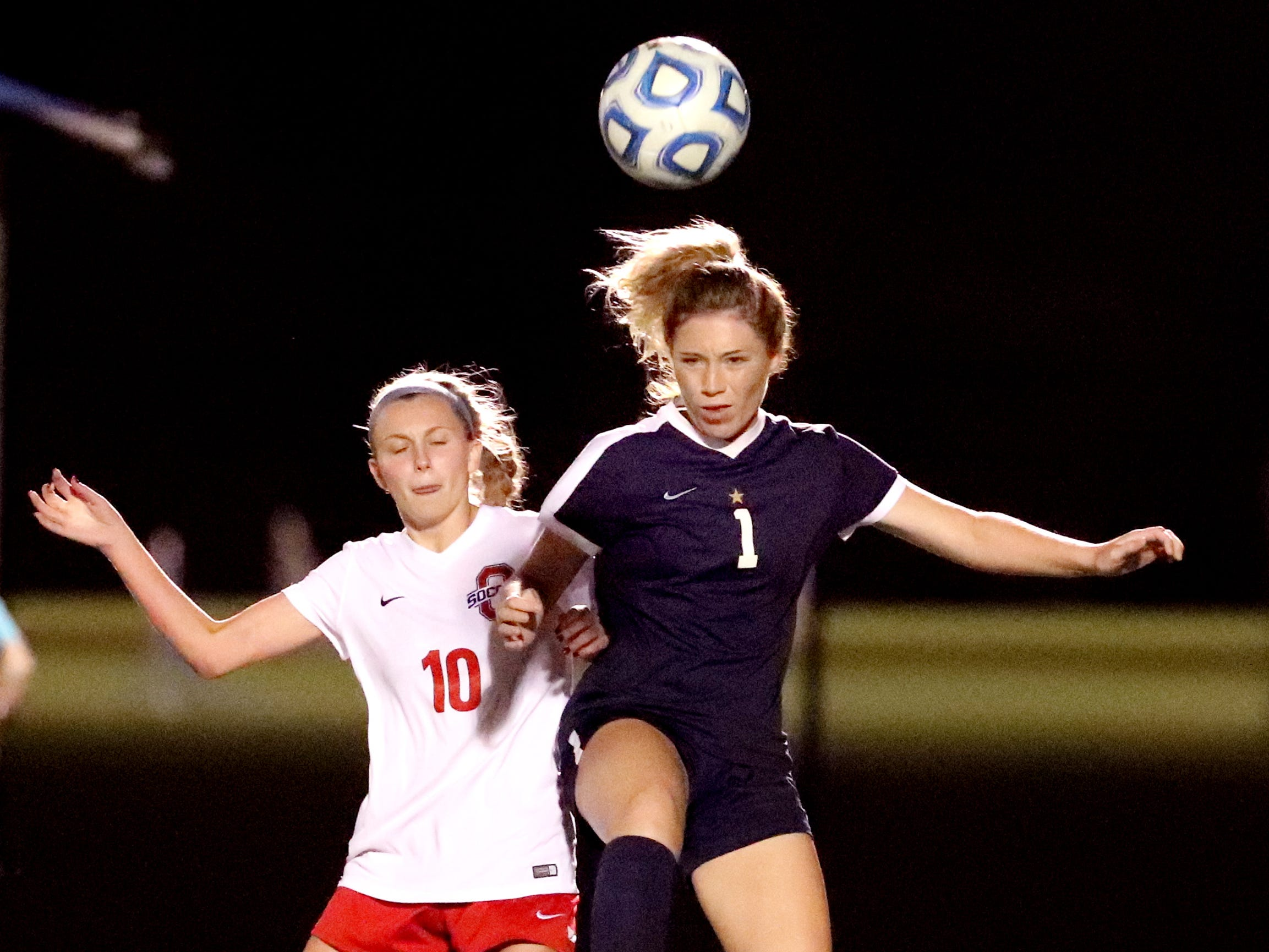 Oakland's Mackenzie Shea (10) and Siegel's Abby Palmer (1) both go after the ball during the semifinals of the 7-AAA Soccer Tournament, on Tuesday,  Oct. 09, 2018 at the Siegel Soccer Complex.