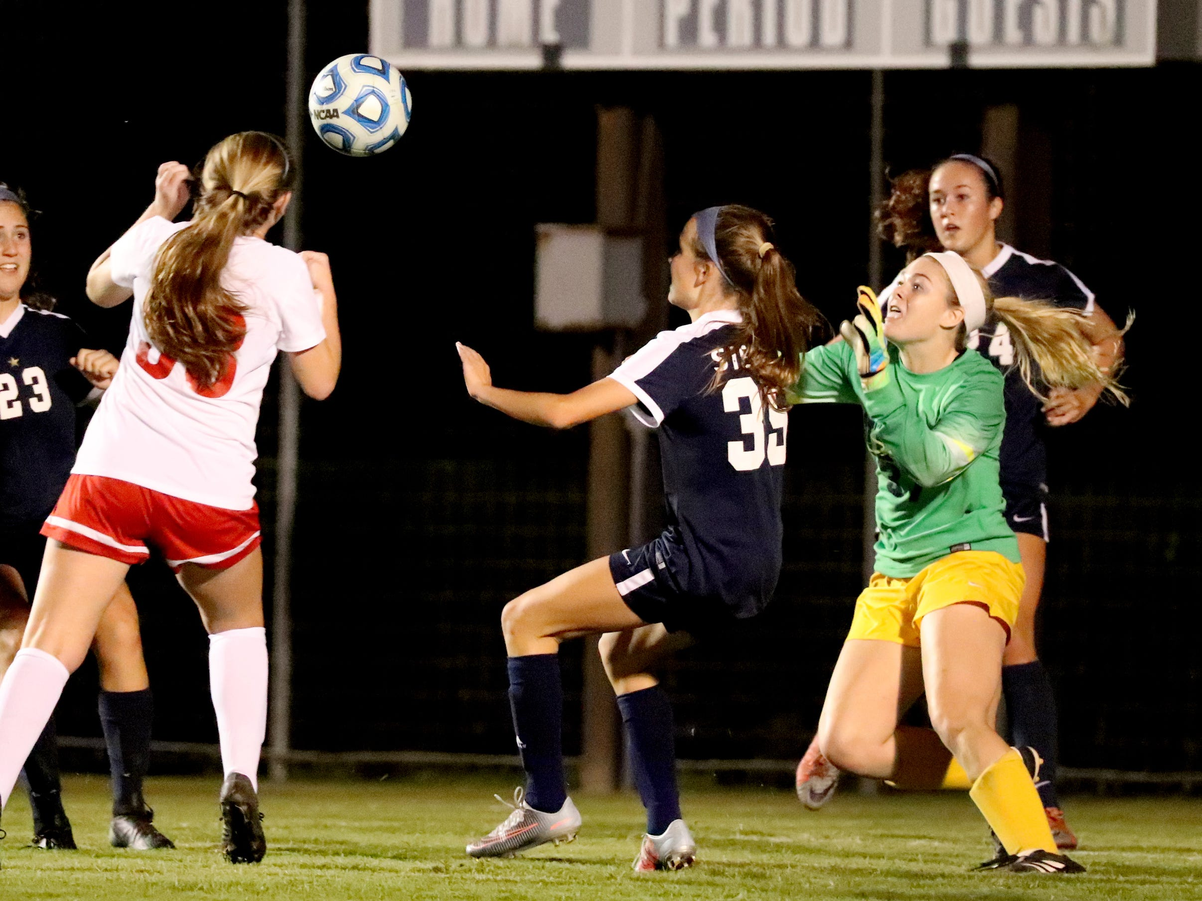 Siegel's keeper Courtney Donnelly (37) moves in to try and make a save against Oakland in the semifinals 7-AAA Soccer Tournament against Oakland, on Tuesday,  Oct. 09, 2018 at the Siegel Soccer Complex.