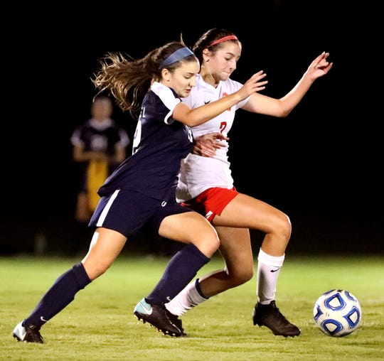 Siegel's Mia Roberts and Oakland's Lainey Callis (7) battle during the 7-AAA soccer tournament.