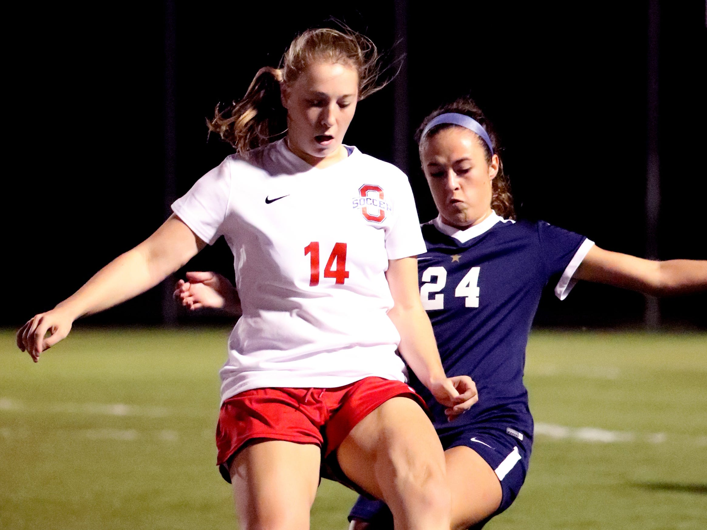 Oakland's Mary Grace Wright (14) and Siegel's Kirsten Wojciechowski (24) go after the same ball in the semifinals of the 7-AAA Soccer Tournament, on Tuesday,  Oct. 09, 2018 at the Siegel Soccer Complex.