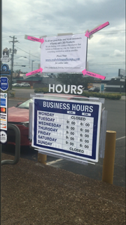A sign on the front of MidTN Hydroponics and Gardening informed customers the shop wasn't selling the CBD products due to a dispute between company partners for Tennessee Hemp Company.