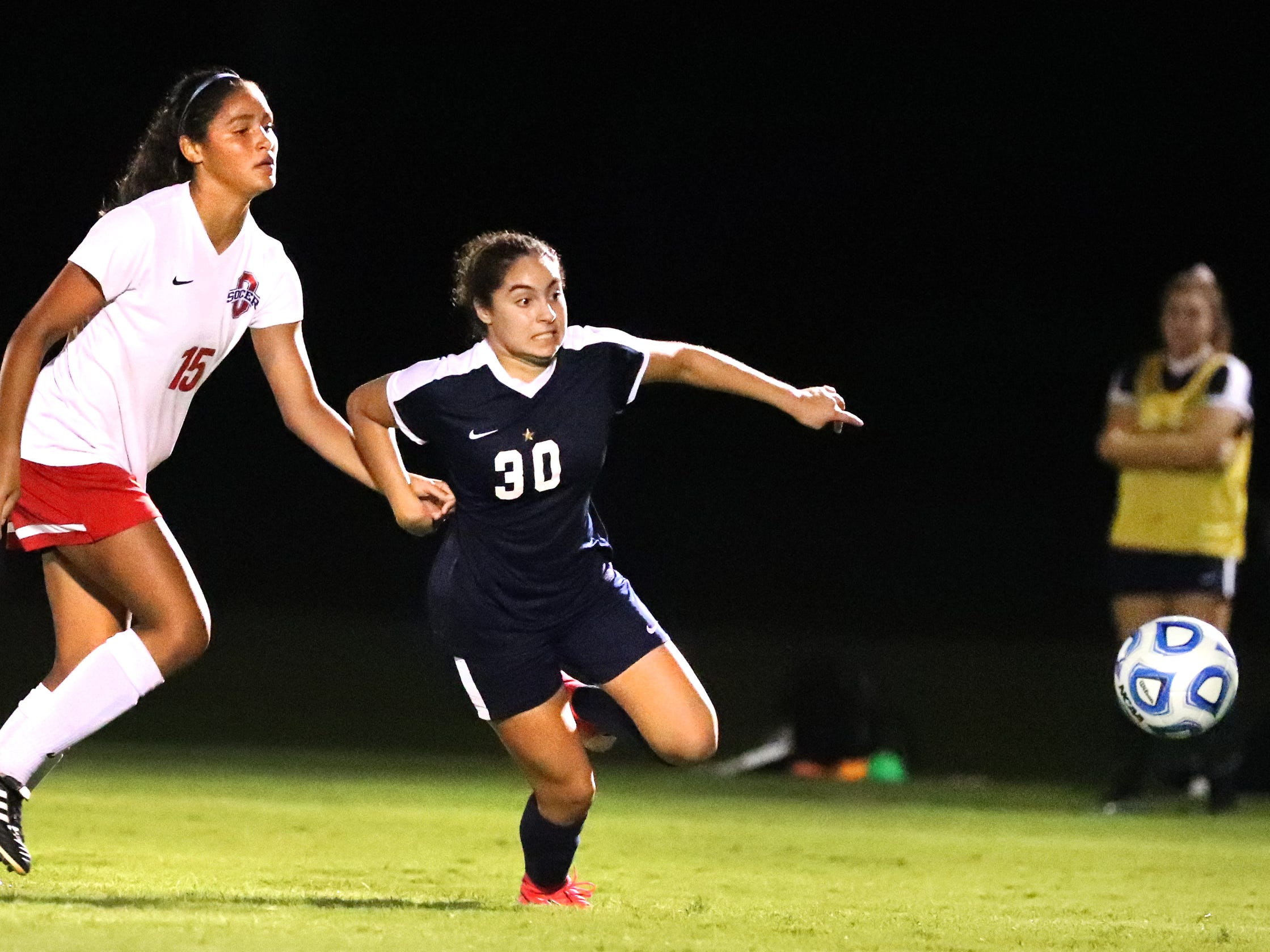 Oakland's Ella Riley(15) and Siegel's Emily Sanchez (30) both go after the ball during the semifinals of the 7-AAA Soccer Tournament, on Tuesday,  Oct. 09, 2018 at the Siegel Soccer Complex.