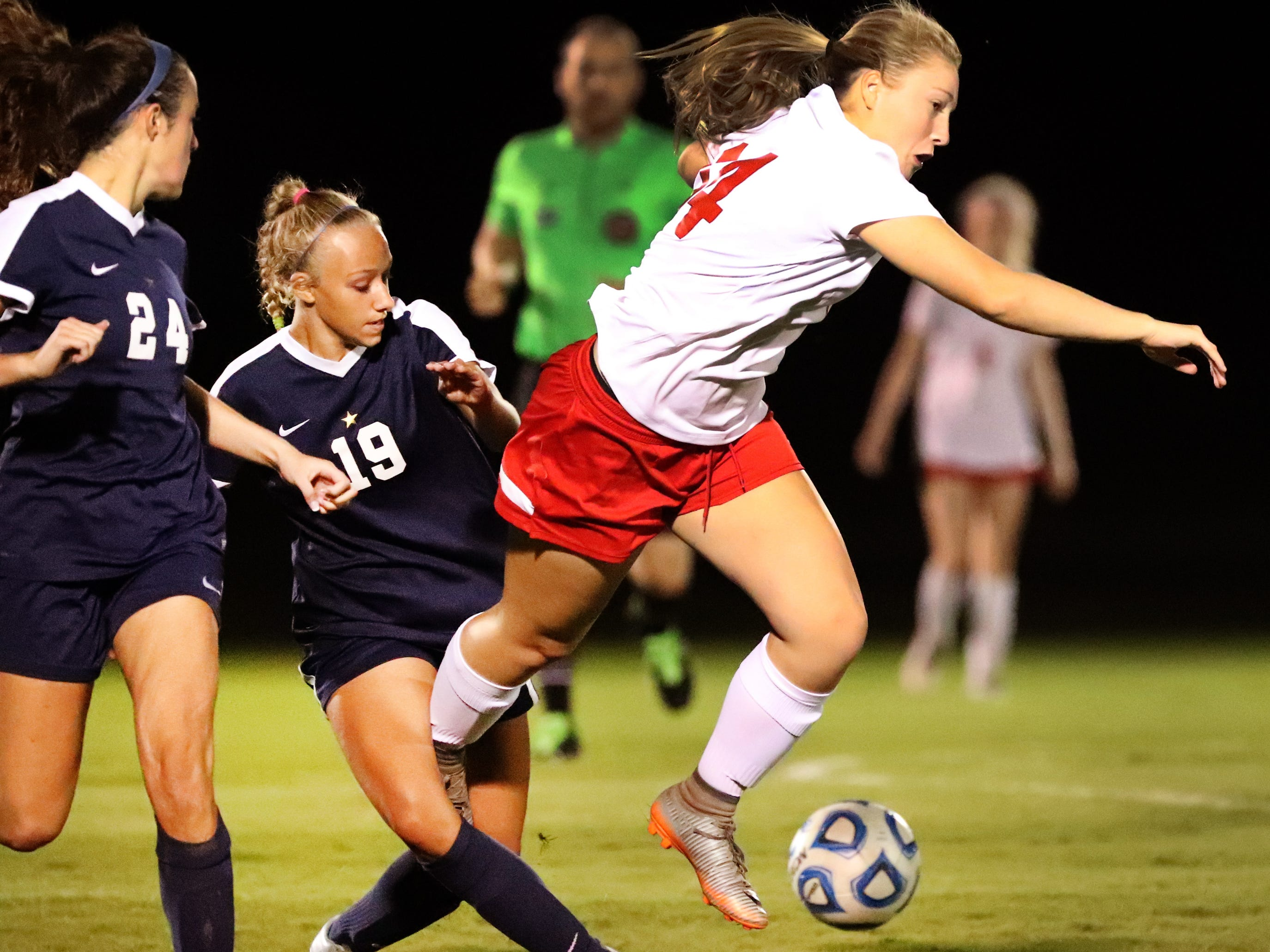 Oakland's Mary Grace Wright (14) trips as she and Siegel's Kayla Hawkins (19) go after the same ball during the semifinals in the 7-AAA Soccer Tournament, on Tuesday,  Oct. 09, 2018 at the Siegel Soccer Complex.