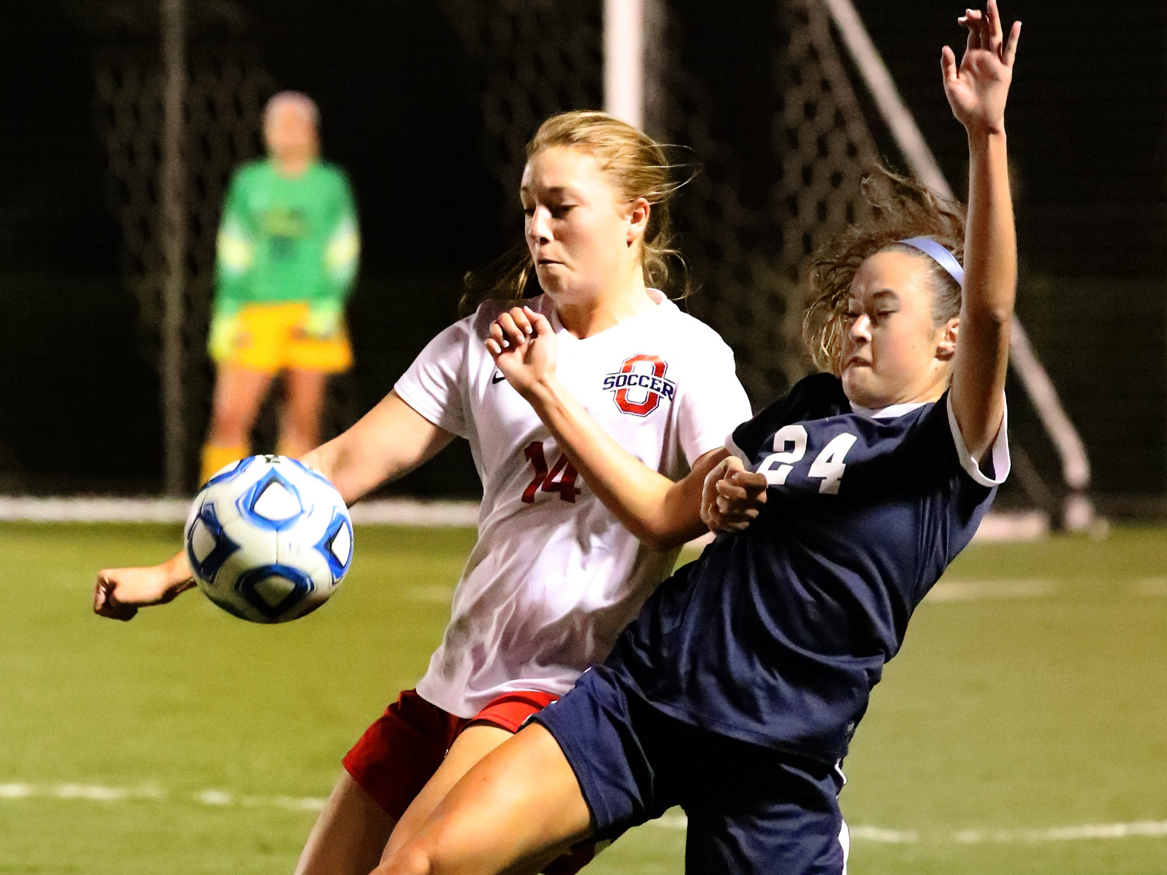 Oakland's Mary Grace Wright (14) and Siegel's Lexus Simpson (34) both go after the ball during the semifinals of the 7-AAA Soccer Tournament, on Tuesday,  Oct. 09, 2018 at the Siegel Soccer Complex.