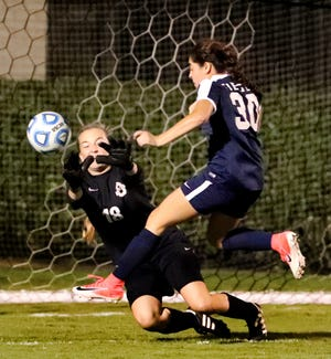 Oakland goalkeeper Sophie Turner moves in for a save as Siegel's Emily Sanchez (30) attempts a goal during Tuesday's 7-AAA semifinals at Siegel Soccer Complex.