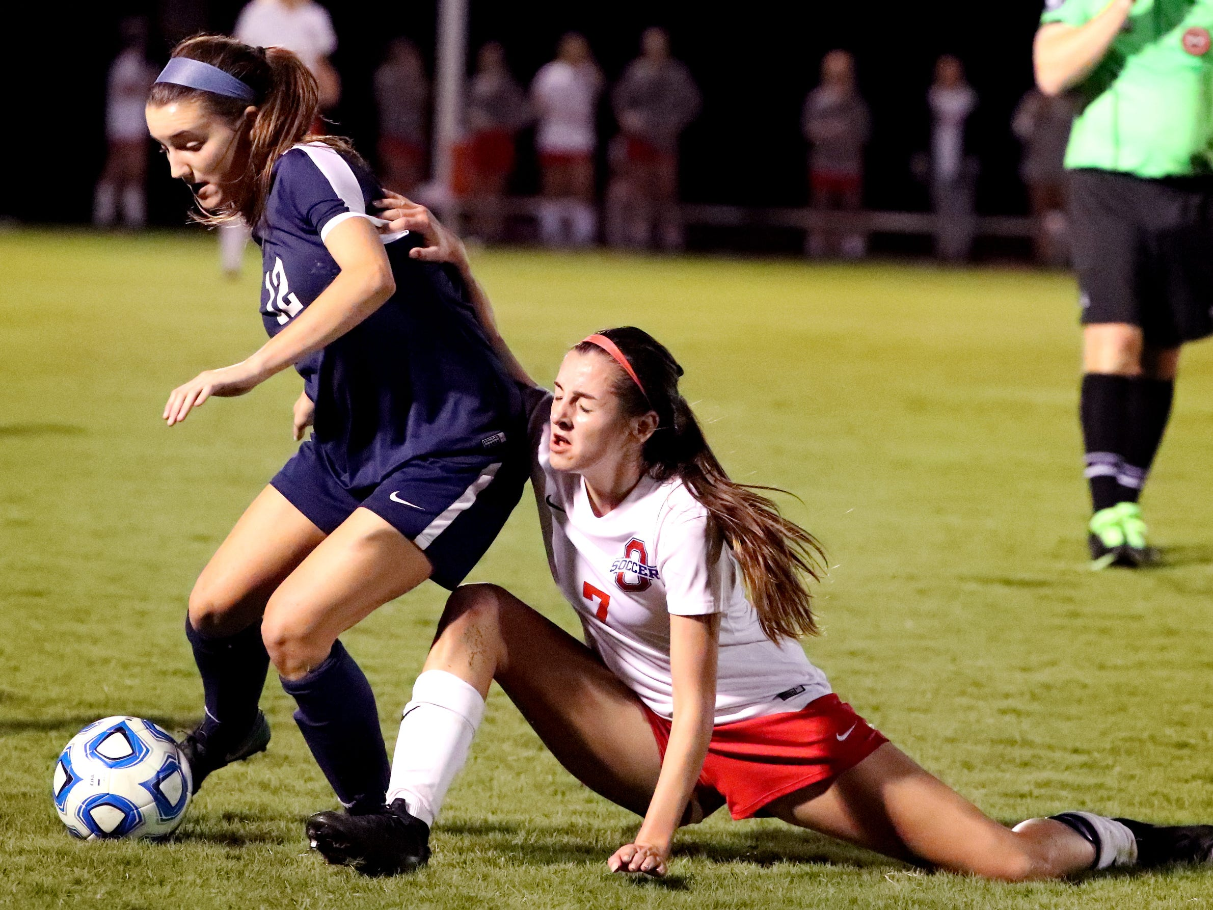 Siegel's Mia Roberts (12) moves the ball down the field as Oakland's Lainey Callis (7) tries to get to the ball in the semifinals of the 7-AAA Soccer Tournament, on Tuesday,  Oct. 09, 2018 at the Siegel Soccer Complex.