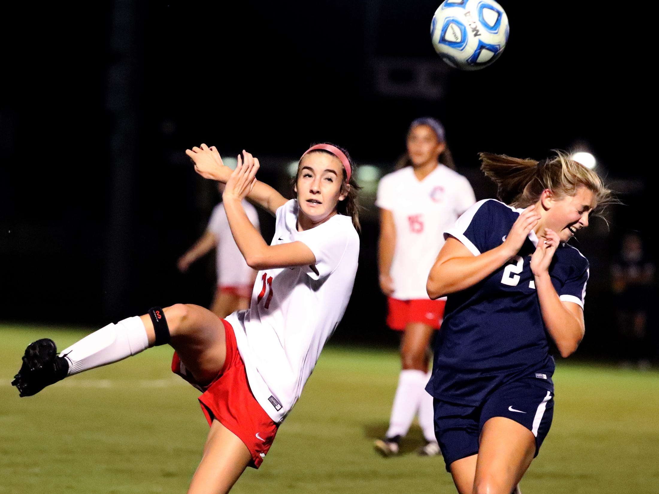 Oakland's Madeline Myers (11) kicks the ball back toward the goal as Siegel's Sloan Ledford (23) rects during the semifinals in the 7-AAA Soccer Tournament, on Tuesday,  Oct. 09, 2018 at the Siegel Soccer Complex.
