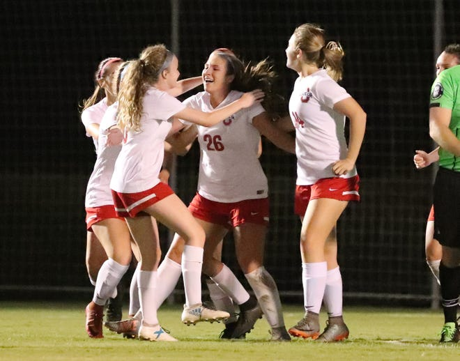 Oakland's Monica Mullaney (26) is congratulated after scoring the only point against Siegel in the semifinals in the 7-AAA Soccer Tournament, on Tuesday,  Oct. 09, 2018 at the Siegel Soccer Complex by Matty Snow (6) and other teammates. Oakland won 1-0.
