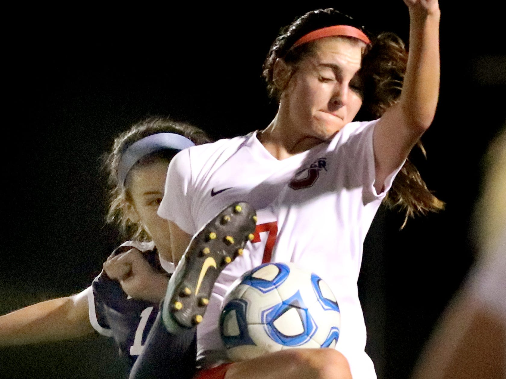 Siegel's Mia Roberts (12) and Oakland's Lainey Callis (7) go after the same ball in the semifinals of the 7-AAA Soccer Tournament, on Tuesday,  Oct. 09, 2018 at the Siegel Soccer Complex.