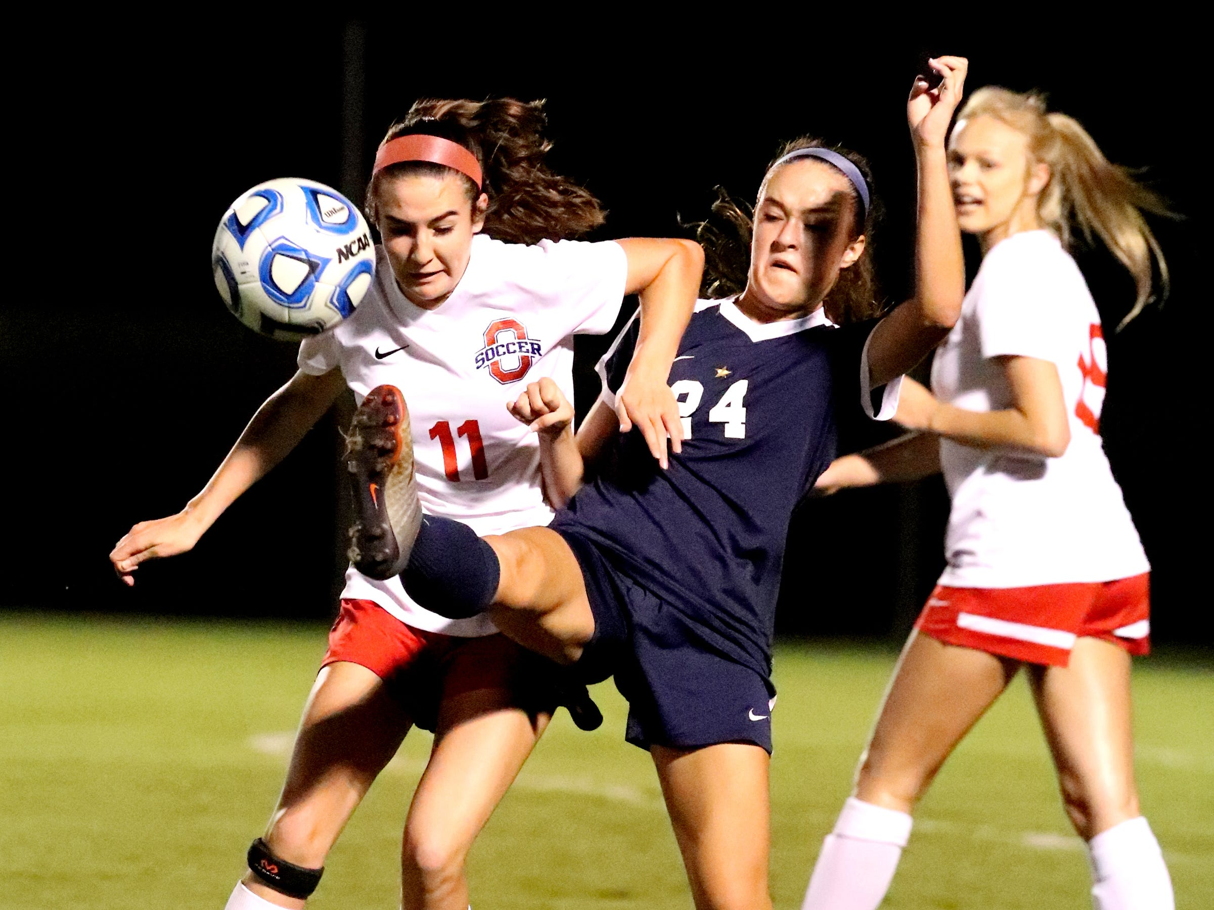 Oakland's Madeline Myers  (11) and Siegel's Kristen Wojciechowski (24) both go after the ball during the semifinals of the 7-AAA Soccer Tournament, on Tuesday,  Oct. 09, 2018 at the Siegel Soccer Complex.