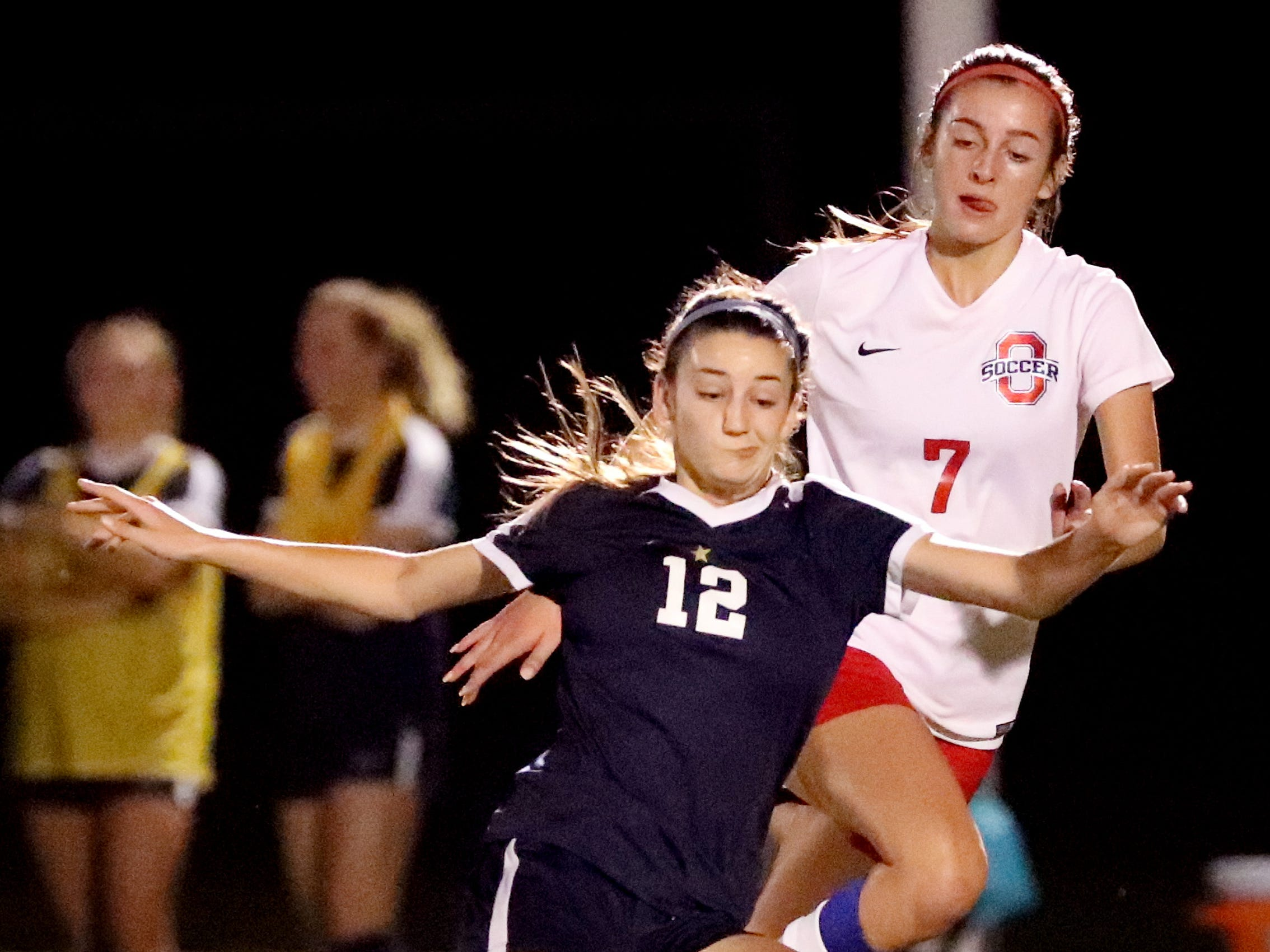 Siegel's Mia Roberts (12) goes after the ball as Oakland's Lainey Callis (7) comes up from behind Roberts in the semifinals of the 7-AAA Soccer Tournament, on Tuesday,  Oct. 09, 2018 at the Siegel Soccer Complex.