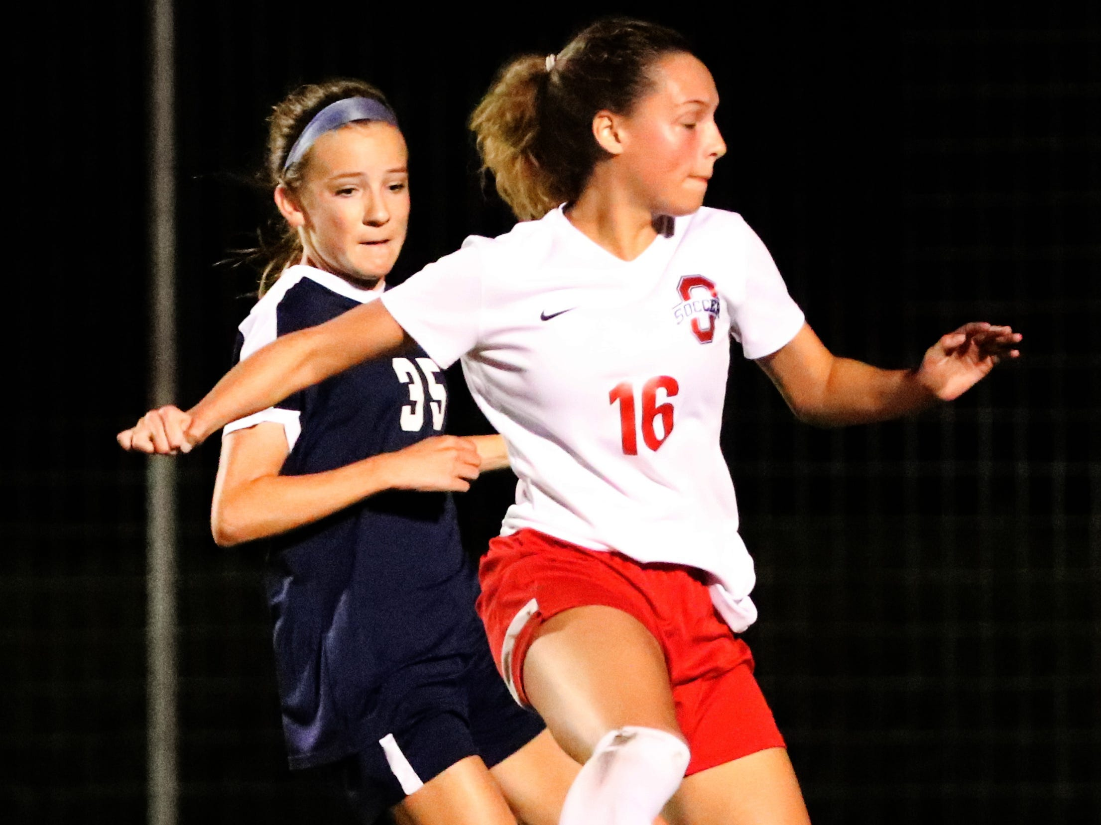 Oakland's Faith Adams (16) moves the ball down the field as Siegel's Allison LaLance (35) comes up from behind her in the semifinals of the 7-AAA Soccer Tournament, on Tuesday,  Oct. 09, 2018 at the Siegel Soccer Complex.