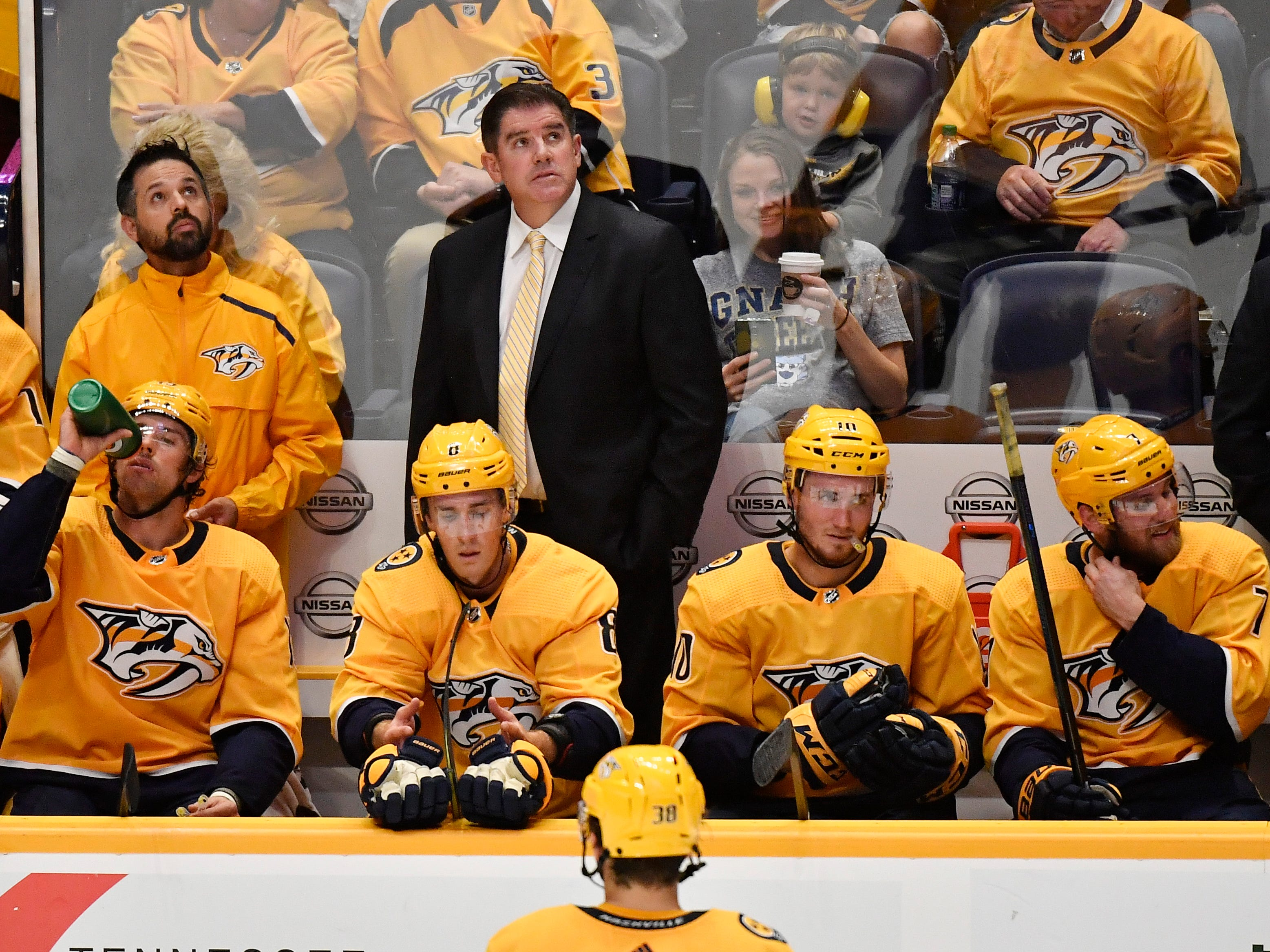 Nashville Predators head coach Peter Laviolette and the players react to being down 2-0 in the second period to the Flames in the home opener at Bridgestone Arena in Nashville, Tenn., Tuesday, Oct. 9, 2018.