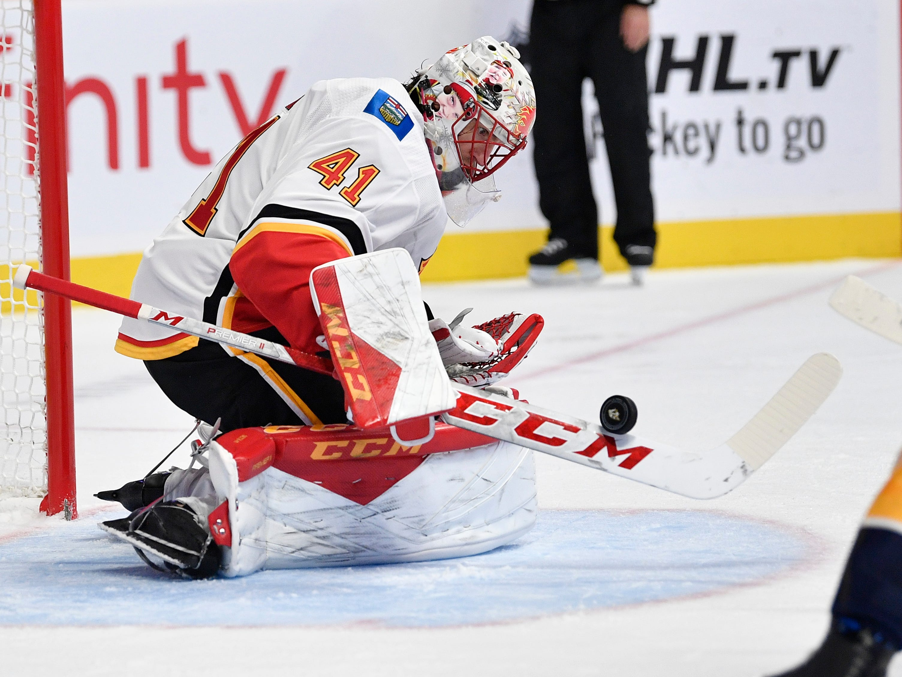 Calgary Flames goaltender Mike Smith (41) stops a Predators shot in the third period of the home opener at Bridgestone Arena in Nashville, Tenn., Tuesday, Oct. 9, 2018.