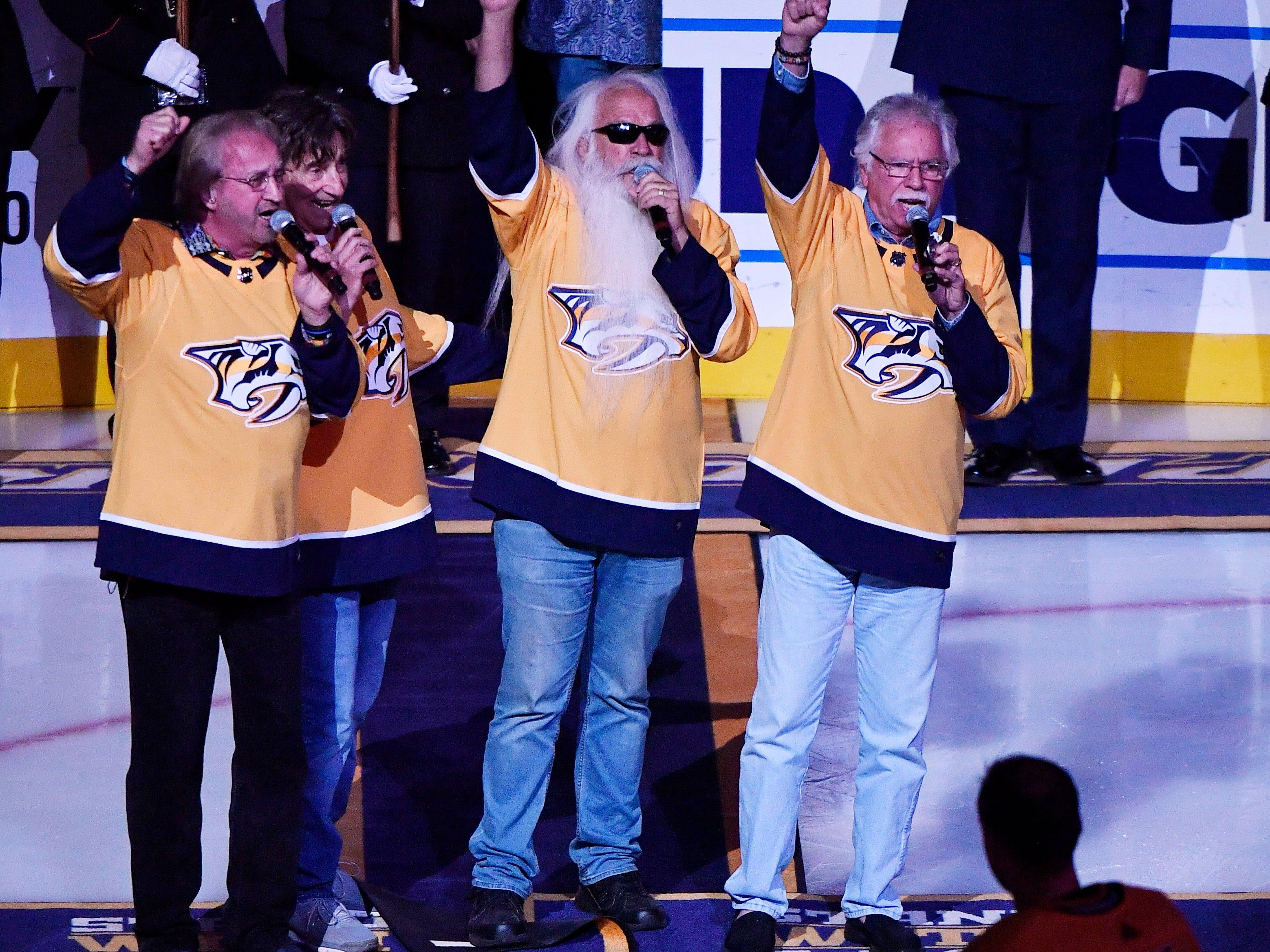 Nashville Predators goaltender Pekka Rinne (35) watches as the Oak Ridge Boys sing the National Anthem before the start of the home opener at Bridgestone Arena in Nashville, Tenn., Tuesday, Oct. 9, 2018.