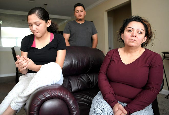 """Geovany Hernandez's mother, Lila Ramirez, right, and his sister, Jasmine, and brother, Ruben, talk about Hernandez's bright personality in their Nashville home on Wednesday. """"Right now I don't know exactly why this happened,"""" the boy's mother said."""