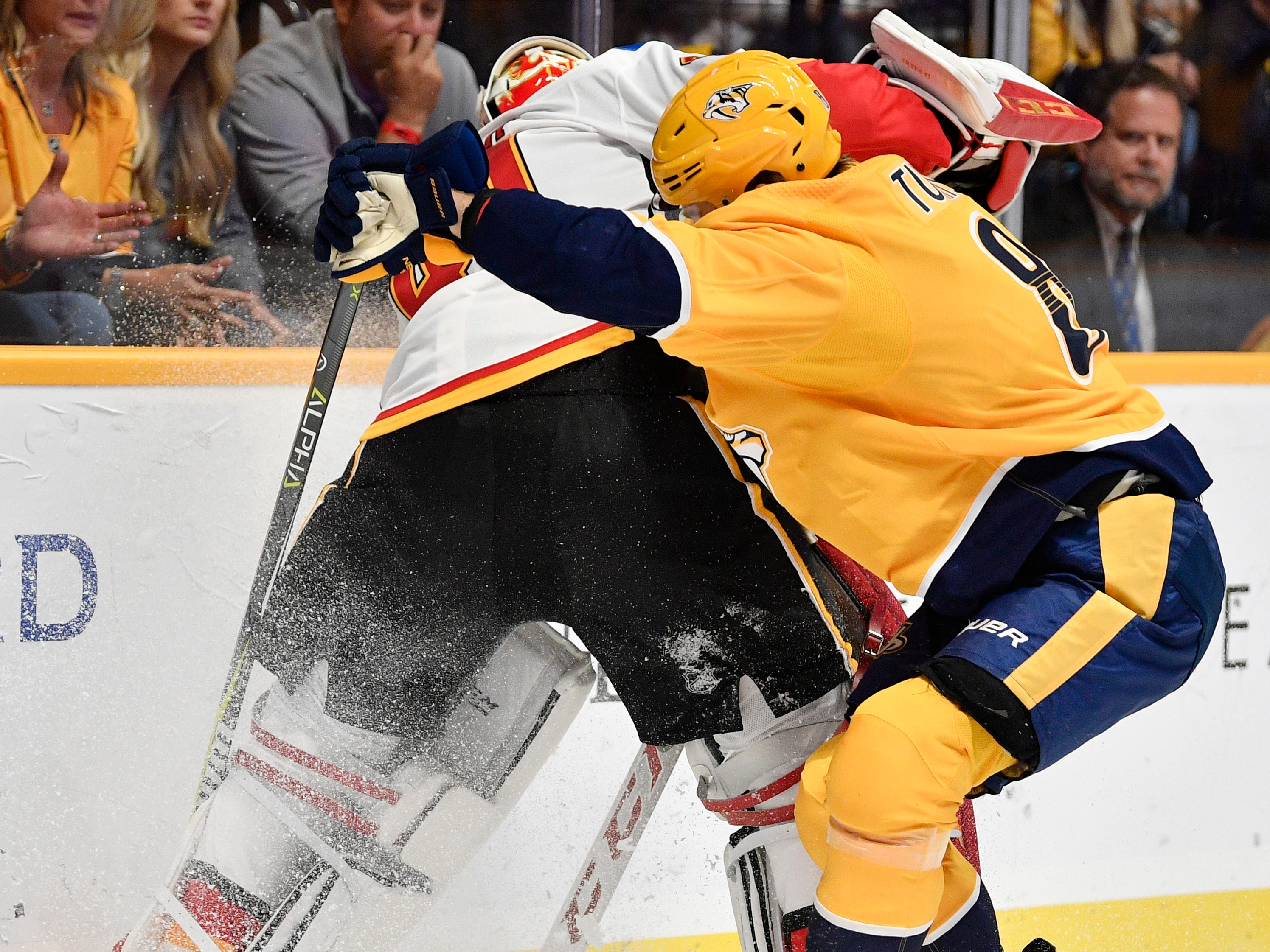 Nashville Predators center Kyle Turris (8) battles with Calgary Flames goaltender Mike Smith (41) in the first period of the home opener at Bridgestone Arena in Nashville, Tenn., Tuesday, Oct. 9, 2018.
