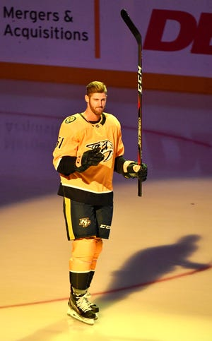 Austin Watson, who was suspended 27 games by the NHL in September, joined his teammates for the player introductions prior to the home opener against the Calgary Flames Tuesday, Oct. 9, 2018.